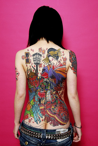 tattoo on back girl. outfit post: sailor stripes
